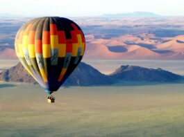 hot air balloon soaring over the namib desert, namibia